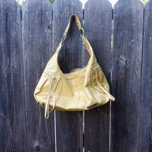 Yellow Kenneth Cole Reaction hobo faux leather bag